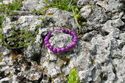 purple sugilite on a rock