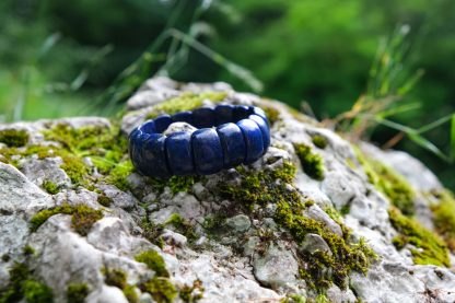deep dark blue Lapis Lazuli perched on a rock, waiting for you to pick it up
